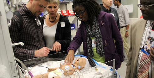 Students take their families on a tour of the medical simulation center