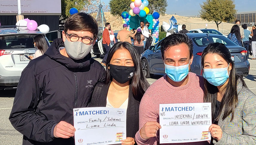 students outside wearing masks at match day 2021